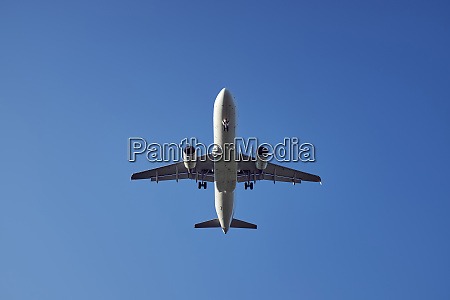 passenger plane during landing upward view