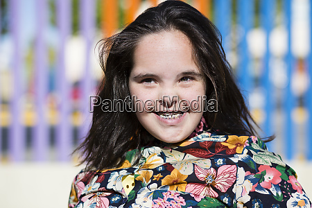 teenager girl with down syndrome smiling