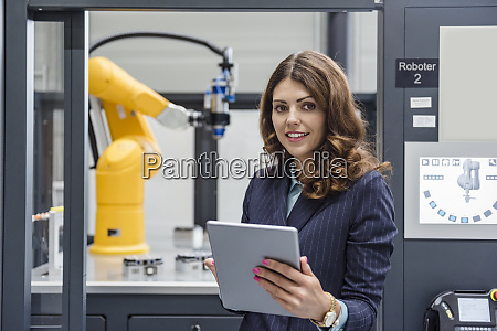 businesswoman working in high tech company