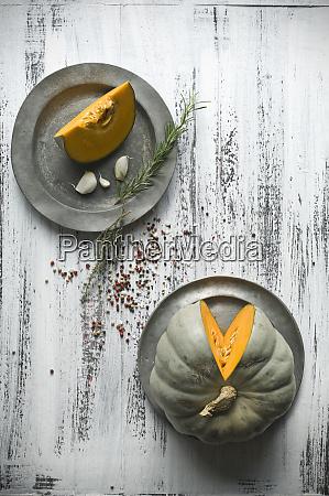 sliced cucurbita maxima on tin plates