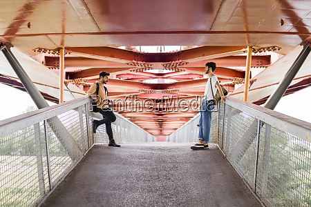 young gay couple standing on modern