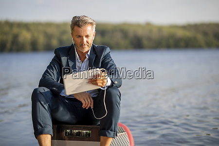 portrait of relaxed businessman with earphones