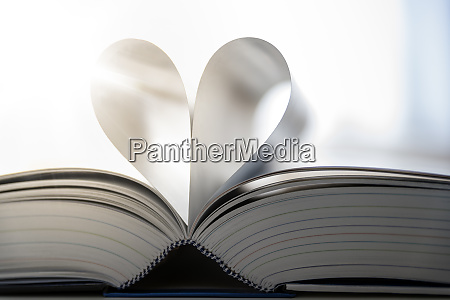sheets of open book building heart