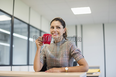 pretty office worker sitting at desk