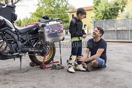 happy father and son next to