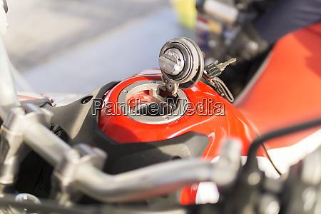 open filler cap of a motorbike