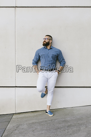 bearded hipster businessman wearing glasses and