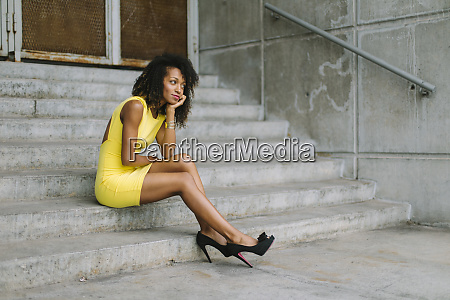 fashionable businesswoman in yellow dress and