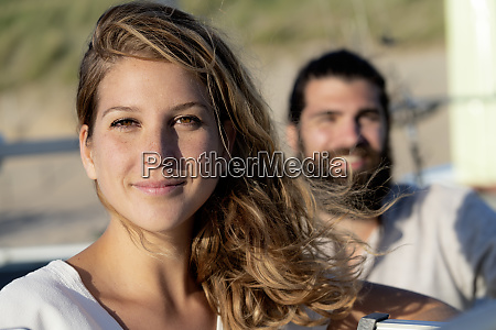 couple on tha beach woman looking
