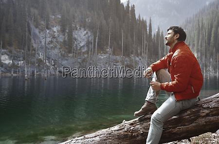 kazakhstan almaty traveler at the lake