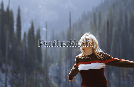 happy blond woman arms outstretched