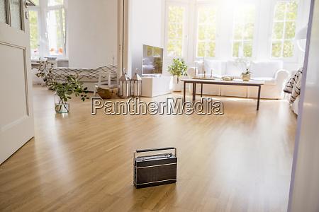 transistor radio standing on parquet in