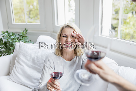 portrait of laughing blond mature woman