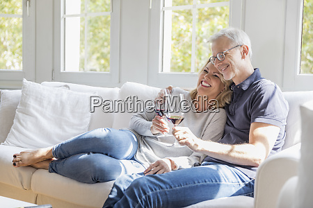 mature couple relaxing on the couch