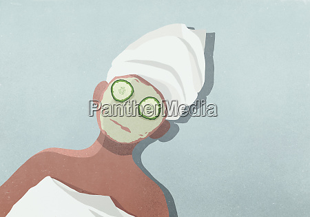 women with face mask cucumber on