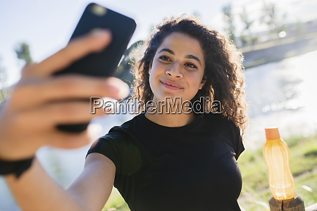 sportive young woman taking a selfie