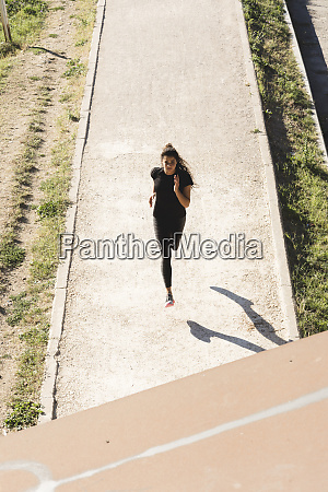 sportive young woman running on a