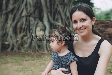 thailand ayutthaya portrait of smiling mother
