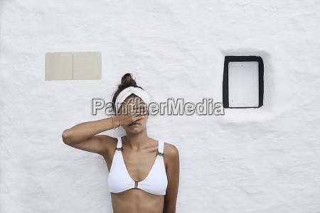 young woman wearing white bikini top