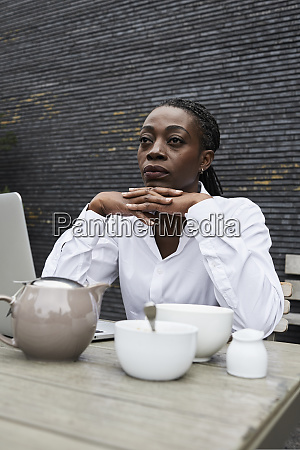 portrait of pensive businesswoman sitting on