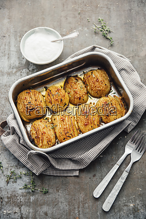 baked hasselback poataoes in baking tray