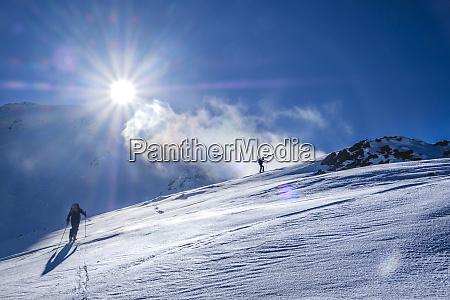 two men doing a ski tour