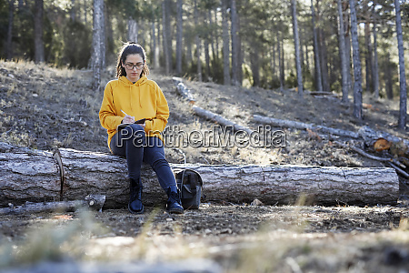 young woman with yellow sweater in