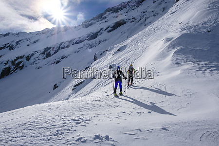 two men doing a ski tour