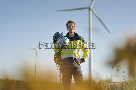 technician standing in a field at