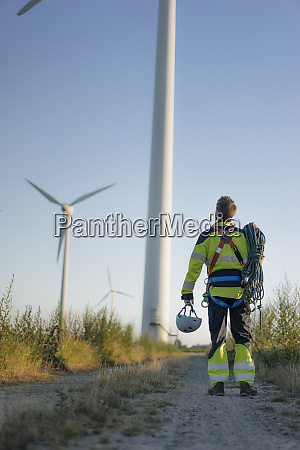 technician standing on field path at