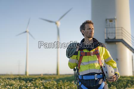 technician standing at a wind farm
