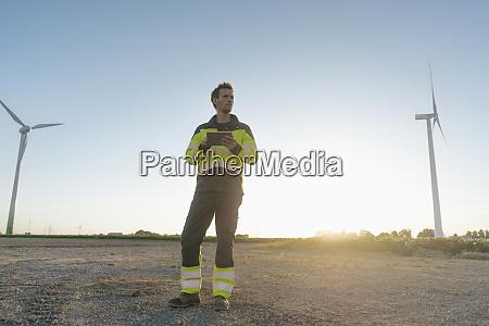 engineer standing in rural landscape at