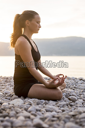 young woman doing yoga at the