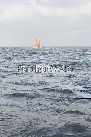 sailboat on choppy ocean