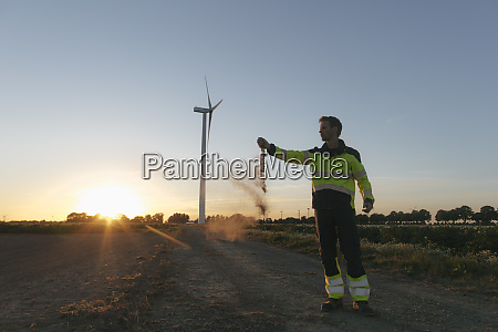 engineer at a wind turbine at