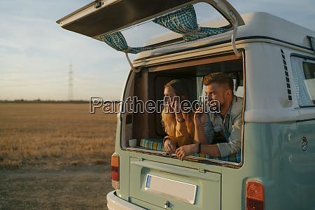 couple brushing teeth in camper van