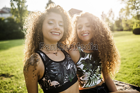 portrait of smiling twin sisters at