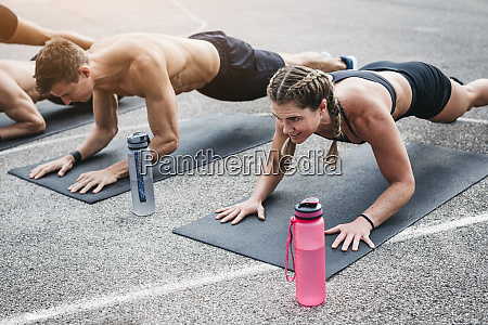 people during workout plank