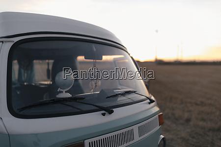 camper van in rural landscape at