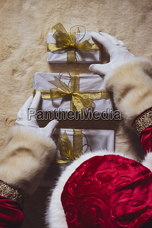 hands of santa claus arranging christmas