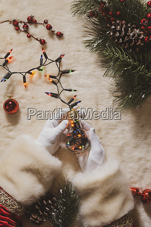hands of santa claus holding fairy
