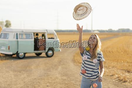 happy young woman at camper van