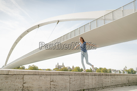 netherlands maastricht young woman balancing on