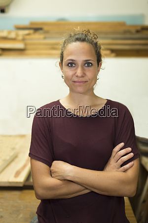 portrait of confident craftswoman in her