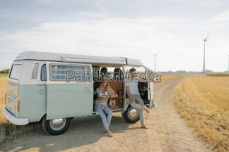 young couple relaxing in camper van