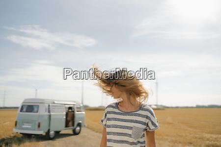 blong young woman at camper van