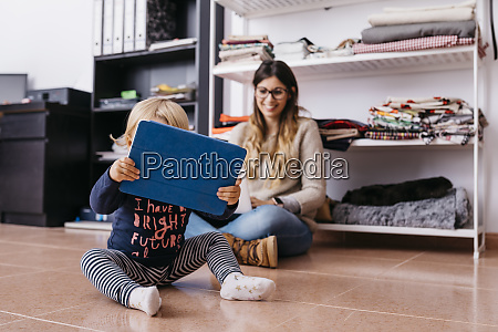 mother and little daughter sitting on