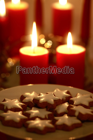 plate of cinnamon stars at candle