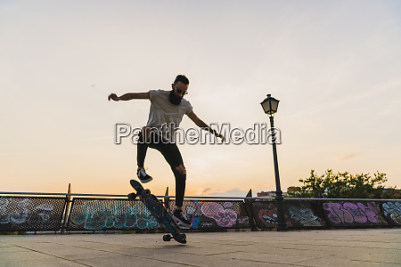 young man doing a skateboard trick