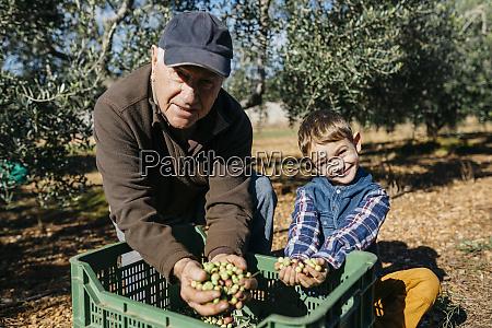 portrait of senior man and grandson